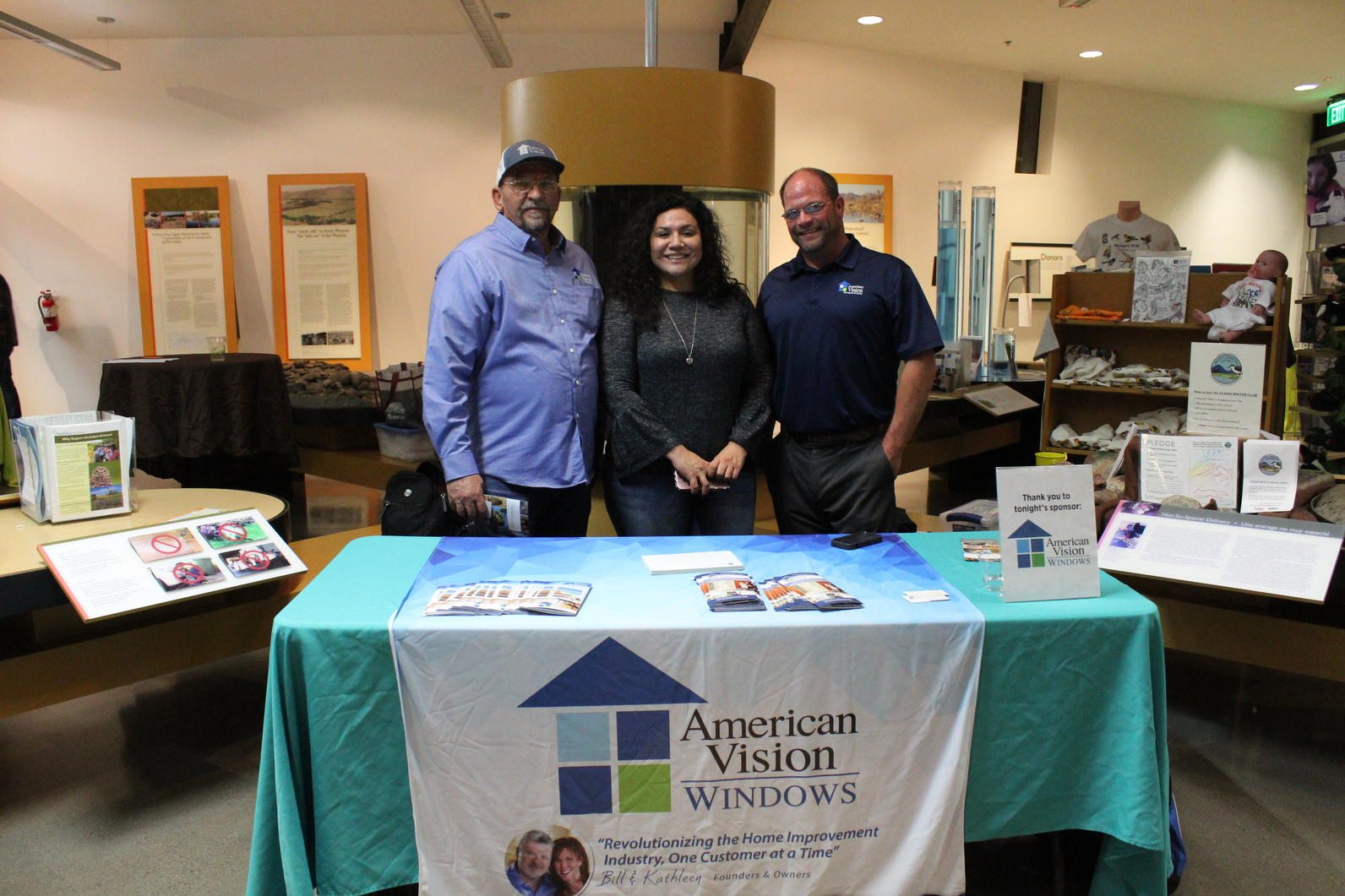Our sponsors from American Vision Windows stand in front of their table at the end of the night.